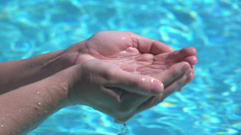 Two videos of hands drawing the water in real slow motion Footage