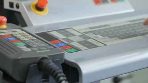 Engineer Sets Machine Task Program on Control Panel Footage