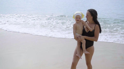 Mother and daughter are singing on the beach Footage