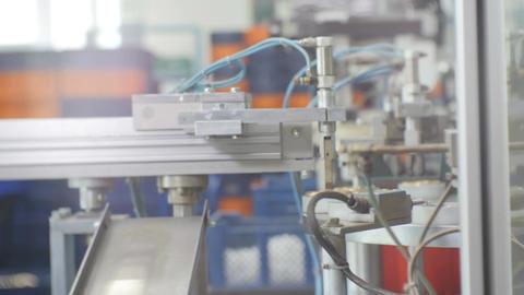 Machine Mechanical Hand Puts Tin Canning Lids on Conveyor Footage