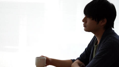 Men drinking hot drinks at a cafe (coffee / tea) Stock Video Footage