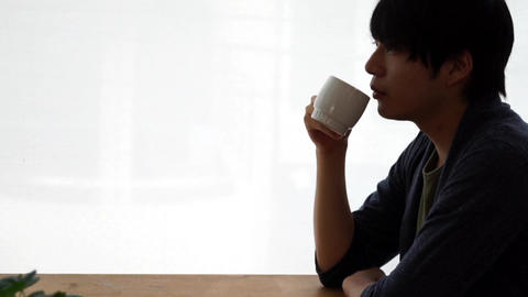 Men drinking hot drinks at a cafe (coffee / tea) Footage