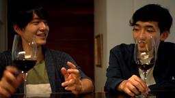 Two men who talk at the bar at night Footage
