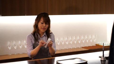 Hospitality industry · female clerk · counter register · hot drink Footage