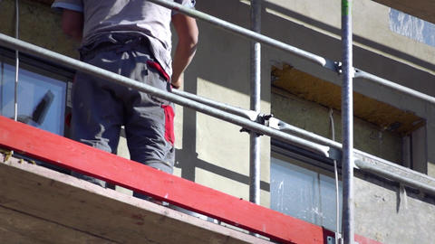 Man working on scaffolding Footage