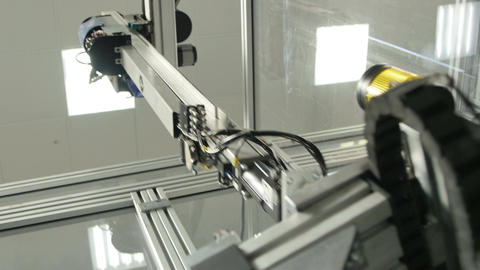 High-tech Machine with Mechanical Arm Operates on Manufacture Footage