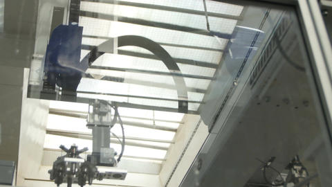 Modern Machine Operates on Manufacture behind Glass Footage