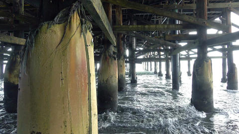 Three videos of walking under pier in 4K Footage