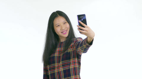 Chinese teenager taking a selfie with smartphone MCU 1 Footage