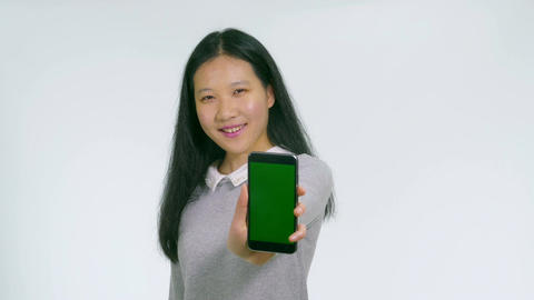 Teenage Asian girl holds up green screen phone 1 Footage