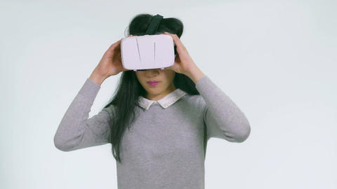 Teenage Asian girl takes off and passes VR goggles 1 Filmmaterial
