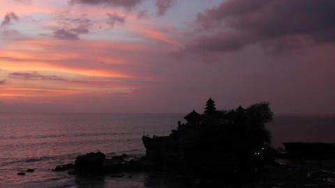 sunset over hindu temple Tanah Lot, Bali, Indonesia Footage