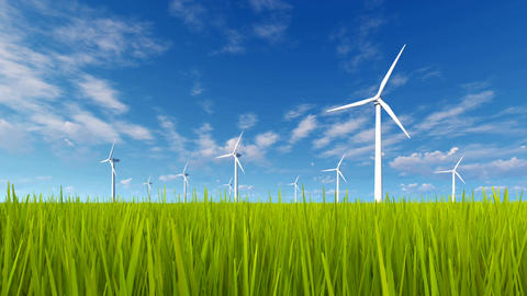Rotating wind turbines and green grass field Footage