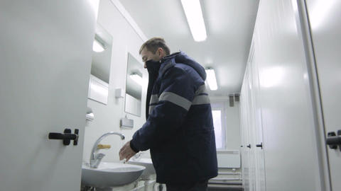 Closeup Worker in Overalls in Public Toilet Wash Hand Footage
