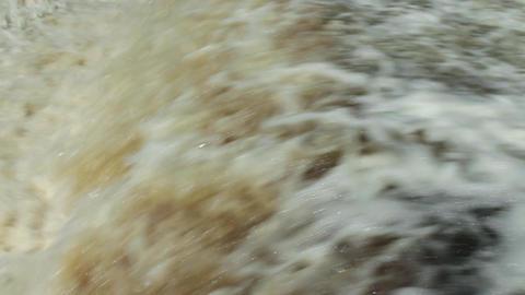 huge flow of water blustering waterfall Footage