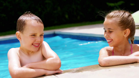 Sibling enjoying in swimming pool Footage