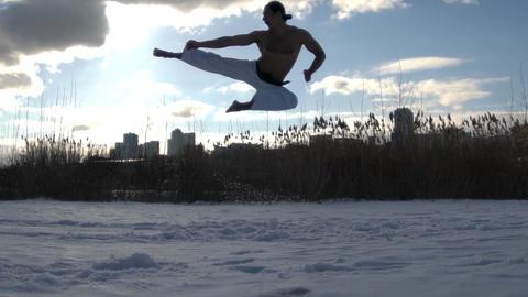 Man Training Taekwondo Or Karate Man Jumping, Slow Motion Live Action