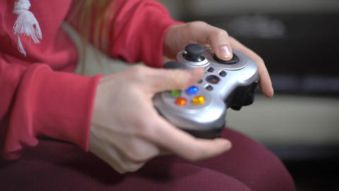 Young Woman Playing Video Game Using A Gamepad Footage