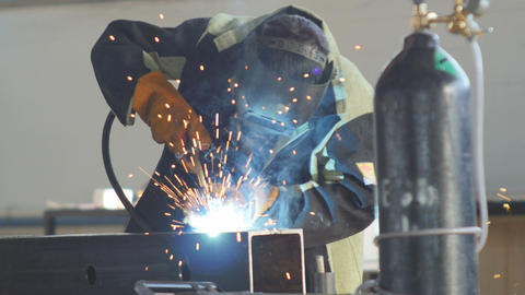 Welder Works with Welding Machine in Work Clothes Footage