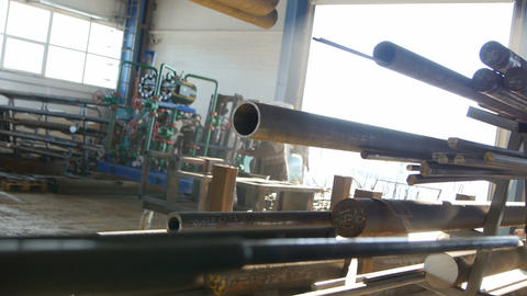 Camera Moves along Steel Pipes At The Factory Footage
