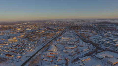Panoramic Aerial View of Industrial City Covered With Snow on Sunrise Footage