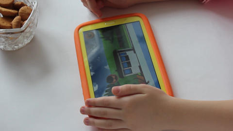 MVI 1977 child plays on tablet play Live Action