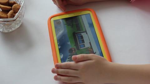 MVI 1977 child plays on tablet play Footage