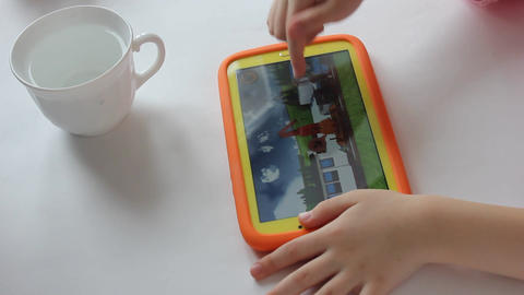 MVI 1979 child plays on tablet play Footage