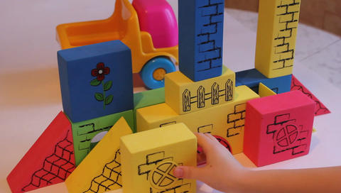 MVI 14081 constructor child collects cubes Footage