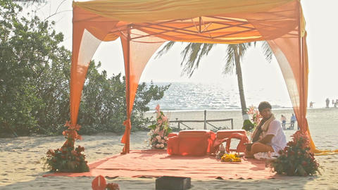 Decorated Wedding Canopy on Ocean Beach in India Closeup Footage