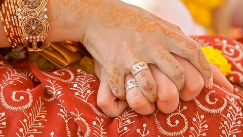 Happy Newlyweds United Hands with Wedding Rings on Fingers Footage
