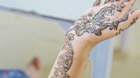 Closeup Girl Shows Patterns with Henna on Palm Wrist Arm Footage