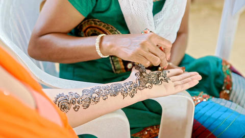 Girl Makes Traditional Painting with Henna on Bride Fingers Footage