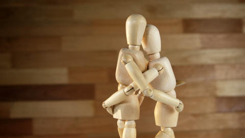 Romantic couple figurines embracing each other Live Action