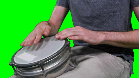 Mid section of drummer playing drum Live Action