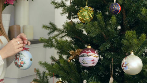 Decorating the Christmas tree with balls Footage
