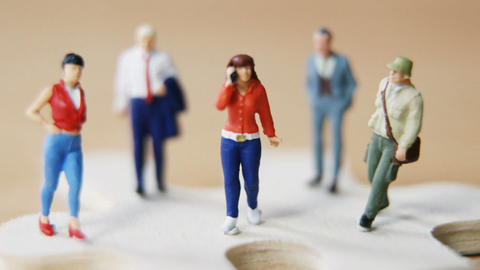 Miniature people travelling Live Action