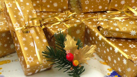 Christmas gifts wrapped in gold paper Footage