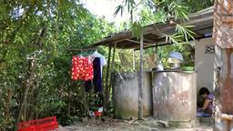 Vietnam Phú Mỹ district villages 036 water tanks under canopy Footage