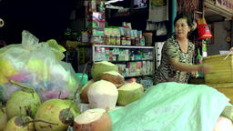 Vietnam Phú Mỹ district villages 060 selling coconuts on a market Footage