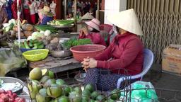 Vietnam Phú Mỹ district villages 064 asian market women in a fruit stand Footage