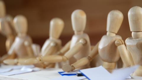 Wooden figurines having meeting in conference room Live Action