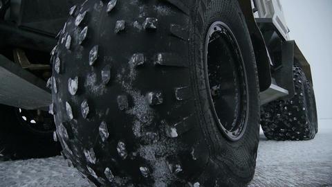 Macro Big Black Truck Wheel Rotates on Road Footage