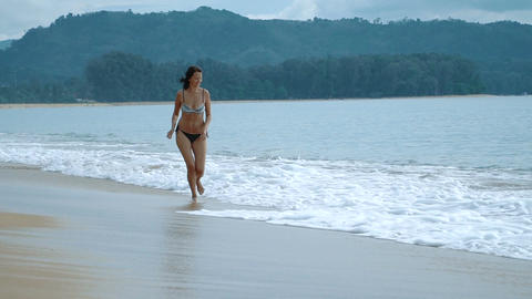 happy woman running on the exotic beach in the summertime Footage