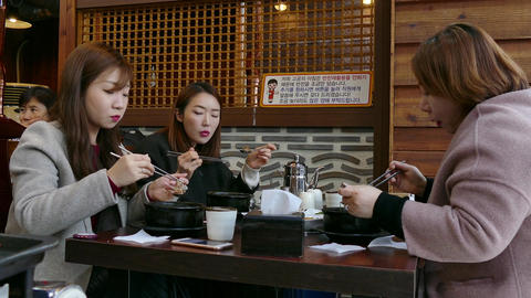 Colleagues Co-workers Eating Lunch In Traditional Korean Restaurant In Seoul Footage