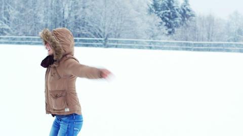 Smiling woman in fur jacket enjoying the snowfall Footage