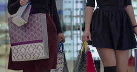 Close-up of women shoppers clothes, walk at shopping mall sale bags HD video Footage