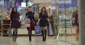 Happy female shoppers walk shopping mall HD video. Friends talk enjoy boutique Footage