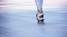 Speed ice skater skating HD video slow-motion. Close-up legs foots skates slides Footage