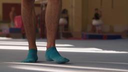 Male gymnast barefoot leg foots walks gymnastic mats flooring HD slow video Footage